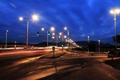 Automobili rapide alla notte Fotografia Stock