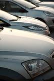 Automobili in una fila Immagine Stock
