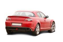 Automobilistico rosso su bianco Fotografie Stock