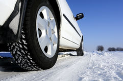 Automotive. Cold winter, a car parked in the snow Stock Photos