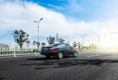 Automotive advertising background map. Driving in the sun on the road fast in a car Stock Photography