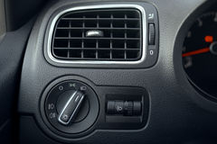 Automotive air conditioning. The flow of air inside the vehicle. Headlamp switch. Detail of the interior of the car Stock Photo