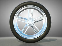 Automotive alloy wheel with tire. And studio light background Royalty Free Stock Photo