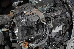 Automotive, burned car battery. Burned and damaged car battery after fire accident Stock Photos