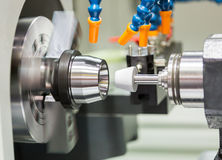 Automotive cnc lathe and cnc grinding part. Operator make automotive parts by cnc lathe and cnc grinding process Royalty Free Stock Image