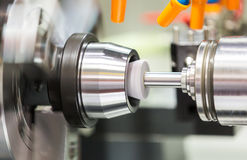 Automotive cnc lathe and cnc grinding part Royalty Free Stock Photography