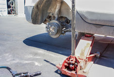 Automotive Concept: Car Wheel is Being Maintained on Professiona Stock Images