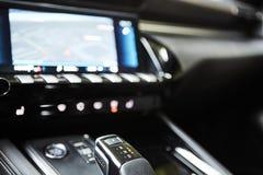 Automotive detail in a luxury car. Modern Luxury car inside. Interior of prestige modern car. Automatic gear stick shift.  stock photos