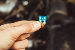 Automotive fuse in hand Royalty Free Stock Photos