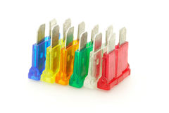 Automotive fuses. Colorful automotive fuses arranged on white background Stock Images