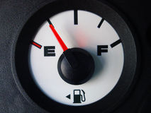 Automotive gas gauge showing nearly empty Stock Photo