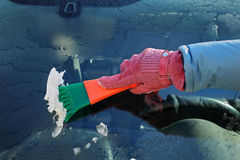 Automotive, ice cleaning from windshield Stock Image