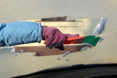 Automotive, ice cleaning from windshield Stock Photography