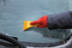 Automotive, ice cleaning from windshield Stock Images