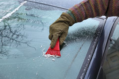 Automotive, ice cleaning from windshield Stock Photos