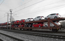 Transportation. Automobiles being transported by rail Stock Image