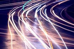 Automotive lighting shadow. Urban road car light trails Royalty Free Stock Photo