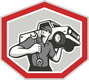 Automotive Mechanic Carrying Pick-Up Truck Stock Photography