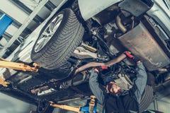 Automotive Mechanic Job. Caucasian Auto Service Worker and the Vehicle Maintenance stock photo