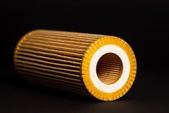 Automotive Oil Filter. On the black background Stock Photos