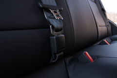 Automotive rear seat belt. Background of close-up of the rear seatbelts of a car Stock Photo