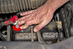 Automotive repair installing a battery Stock Photography