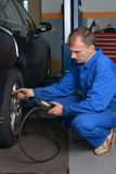 Auto Service Technician Checking Tire Pressure Royalty Free Stock Photo