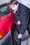 Automotive Technician Auto Mechanic Loosens Lug Nut Front Tire Stock Photo