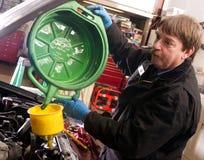 Automotive Technician Auto Mechanic Refills Radiator Service Royalty Free Stock Image