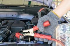 Automotive technician charging vehicle battery Royalty Free Stock Image