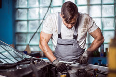 Automotive technician fixing problem Stock Photos