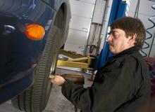 Automotive Technician Uses Pneumatic Impact Wrench Auto Repair stock photo