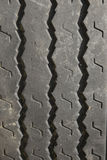 Automotive tire tread design. Close up of automotive rubber tire tread abstract pattern Stock Image