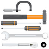 Automotive Tools. Collection of automotive service tools. Includes micrometer, combination wrench, ball pein hammer, screwdrivers, ratchet, and socket Royalty Free Stock Photos