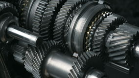 Automotive transmission gearbox. Cogs and gears in motion stock video footage