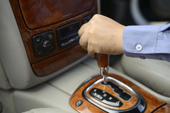 Automotive and transpotation concept. Man hand shifting an automatic car royalty free stock images