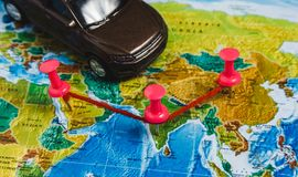Automotive Travel Destination Points on World Map Indicated with Colorful Thumbtacks, Rope and Shallow Depth of Field. Automotive Travel Destination Points on Stock Images