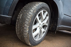 Automotive wheel on dirty country road Royalty Free Stock Images