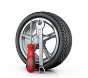 Automotive wheel with tools Stock Photos
