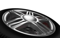 Automotive Wheel Or Tyre. Background closeup on automotive wheel on an alloy metallic rim and hub with spokes lying on its side as though removed for a breakdown Royalty Free Stock Photos
