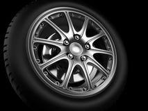 Automotive Wheel Or Tyre. Background closeup automotive wheel with alloy metallic rim Stock Image