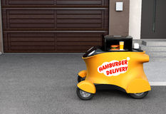 Autonomous delivery robot car in front of the garage with copy space on the left Royalty Free Stock Photo