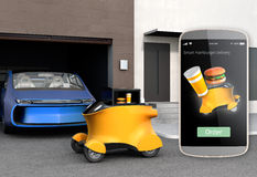 Autonomous delivery robot in front of the garage waiting for picking hamburge Stock Image