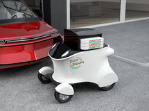 Autonomous delivery robot in front of the garage waiting for picking pizza Royalty Free Stock Photography