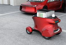 Autonomous delivery robot in front of the garage waiting for picking pizza Royalty Free Stock Photo