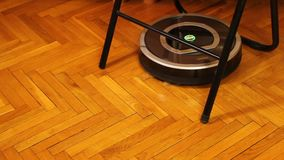 Autonomous robovac stuck while cleaning the floor, modern vacuuming process. Stock footage stock video footage
