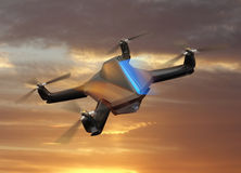 Autonomous unmanned drone with surveillance camera flying in sunset sky Stock Photo