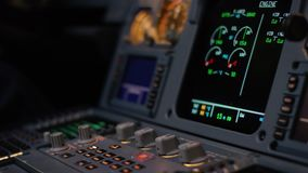 Autopilot control element of an airliner. Panel of switches on an aircraft flight deck. Thrust levers of a twin engined. Airliner. Pilot controls the aircraft stock video footage