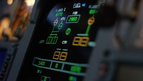 Autopilot control element of an airliner. Panel of switches on an aircraft flight deck. Thrust levers of a twin engined. Airliner. Pilot controls the aircraft stock footage