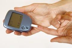 Autoprueba de la diabetes Fotografía de archivo libre de regalías